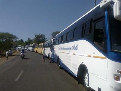 The tour buses caravan...